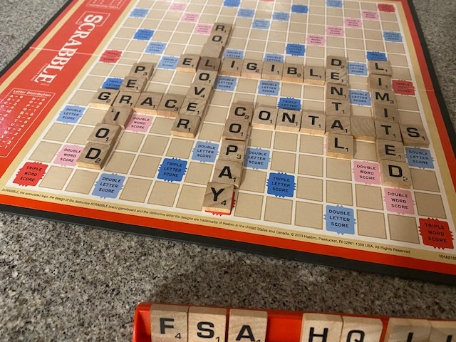 Picture of a Scrabble board with the letters FSA in the front